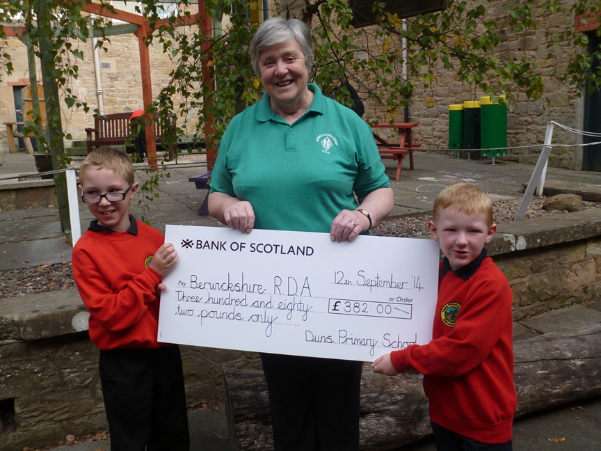 "The school raised money for the RDA riding for the disabled, by coming to school dressed as a ""sporting hero"". The whole school raised nearly £400. What a fantastic effort! Here, Mrs Morgan is receiving a cheque from 2 pupils who take part each week."