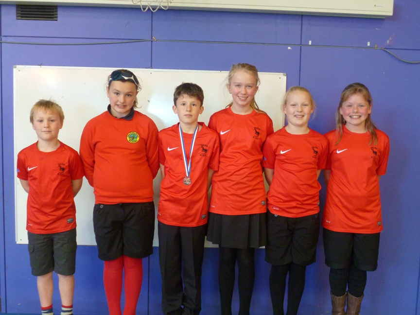 Members of the Duns Primary School swimming team who swam in a competition at Prestonpans. They all swam well and even came back with one medal
