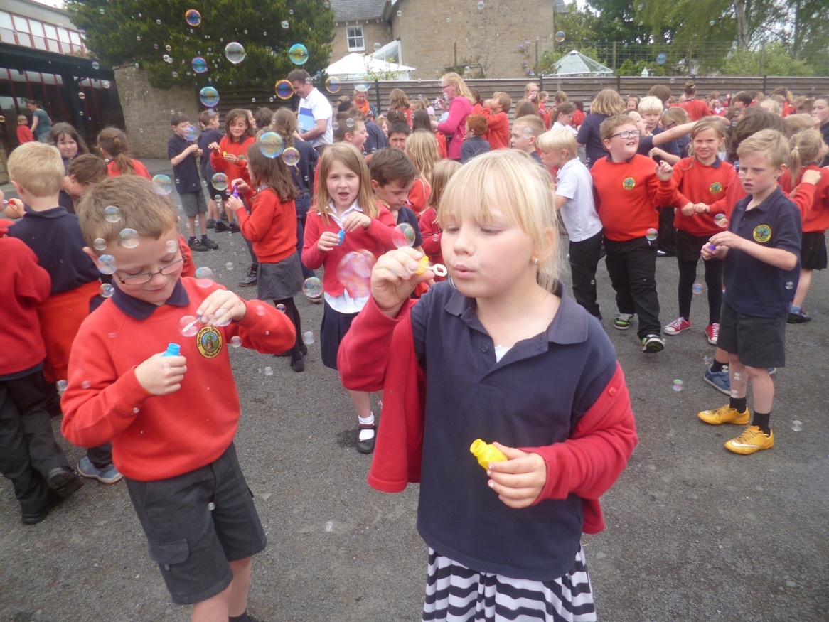 Children bubble blowing in playground